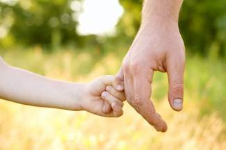 parent holding child's hand